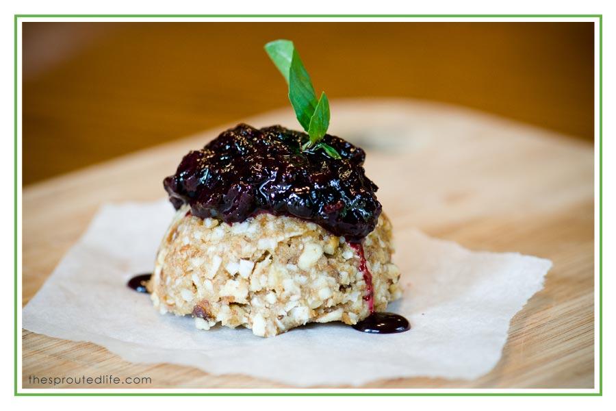 nut truffle with blueberry-basil sauce